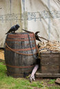 Medieval objects crow on the old wooden barrel and other in front of the knigt tent Stock Photo