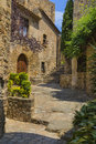 Medieval old town cityscape in pals catalonia village landmark on a cobble stone path with stairs and ancient houses Royalty Free Stock Images