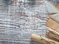 Medieval parchment roll of paper plume on vintage wooden board Royalty Free Stock Photo
