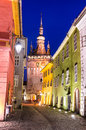 Medieval sighisoara romania street in with clock tower built to protect the main gate of city saxon landmark of transylvania in Stock Images