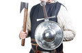 Medieval solder man in soldier clothing with shield and sword and axe Royalty Free Stock Photography