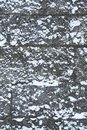 Medieval stone wall is covered with snow, design background with copy space for text Royalty Free Stock Photo