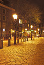 Medieval street in amsterdam netherlands by night the Royalty Free Stock Photos