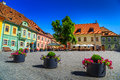 Medieval street cafe bar sighisoara transylvania romania europe stone paved old with in city center fortress Royalty Free Stock Photo