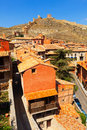 Medieval street with old fortress wall in albarracin aragon Stock Photos