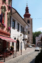 Medieval street and Saint George church in Ptuj, town on the Drava River banks, Slovenia Royalty Free Stock Photo