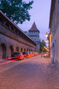 Medieval street in sibiu romania th century fortification tower and wall old town at twilight Royalty Free Stock Photo