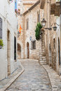 Medieval street in sitges old town spain stone catalonia near barcelona Royalty Free Stock Photo
