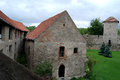 Medieval stronghold imposing walls with a green lawn Royalty Free Stock Images