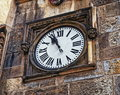 Medieval timepiece adjacent to the main door of the Prague City Hall. Czech Republic. Prague Royalty Free Stock Photo
