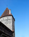 Medieval tower against the blue sky Royalty Free Stock Photo