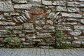 Medieval wall fortification of the old brick in the ancient town Stock Photography