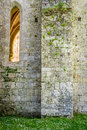 Medieval wall of white stone with a high window made Royalty Free Stock Image