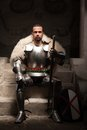Medieval warrior in armor and fur mantle