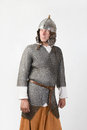 Medieval warrior man wearing in ancient mail armor on white Royalty Free Stock Image