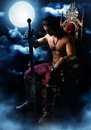 Medieval warrior on the throne on background of the moon half naked with a sword in mystic Stock Photography
