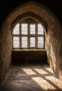 Medieval window light strong white pouring through mullioned windows and casting shadows into an alcove in a castle chirk wales uk Stock Photography