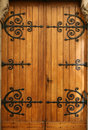 Medieval wood door, wrought-iron details Royalty Free Stock Images