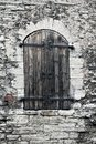 Medieval wooden shutter at a window in an ancient stone wall. Tallinn Royalty Free Stock Photo