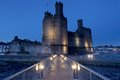 Medievil caernarfon castle at twilight in north wales Royalty Free Stock Photo