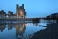 Medievil caernarfon castle at twilight in north wales Stock Image