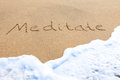 Meditate - written in the sand Royalty Free Stock Image