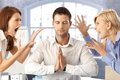Meditating businessman with arguing colleagues Royalty Free Stock Photo