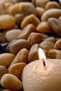 Meditation Candle Burning on Brown Pebbles Royalty Free Stock Photo