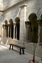 Meditation courtyard bench in an internal for columns and arches peaceful Royalty Free Stock Image