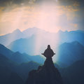 Meditation in a high mountain valley. Instagram stylization Royalty Free Stock Photo
