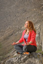 Meditation in mountains young beautiful woman doing Stock Photo