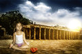 Meditation power girl child meditating at sunset sunrise with dramaticl sky Stock Images