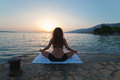 Meditation at the sea woman in yoga pose Royalty Free Stock Image