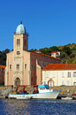 Mediterranean church with fishing boat in the harbor of port vendres vermilion coast roussillon france Stock Photo