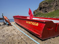 Mediterranean coast beach a boat of lifeguards in italy Stock Photos