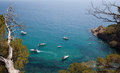 Mediterranean coast leisure boats lazily anchored off an idyllic view from above Stock Images