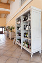 Mediterranean interior wine cabinet a big with bottles Royalty Free Stock Photography