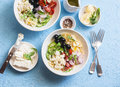 Mediterranean pasta salad. Pasta  farfalle, tomatoes, cucumbers, olives, feta cheese and arugula salad. On a blue background, top Royalty Free Stock Photo