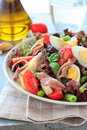 Mediterranean salad with anchovies and olives green beans Stock Image