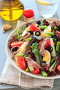 Mediterranean salad with anchovies and olives green beans Royalty Free Stock Photos