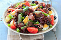 Mediterranean salad with anchovies and olives potatoes Stock Image