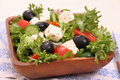 Mediterranean salad gigantic black olives sheeps cheese close up Stock Photos