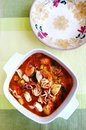 Mediterranean sea food stew a photograph showing a delicious and fragrant dish of style seafood or soup full of fish prawns Stock Photos