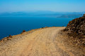 Mediterranean sea and gravel dangerous road which leads to gramvousa beach on island of crete in greece Royalty Free Stock Photography