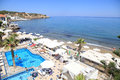 Mediterranean sea and swimming pool on summer hotel resort, Gree Royalty Free Stock Photo