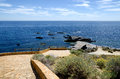 Mediterranean seascape sea with rock and path Stock Photos