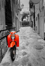 Mediterranean street with retro scooter Stock Photo