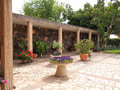 Mediterranean style garden typical classical with blooming flowers and stone work Royalty Free Stock Photo