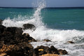 Mediterranean surf breaks over the rocks at golden bay beach malta easter Stock Photos