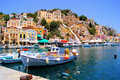Mediterranean village beautiful boat lined harbor at symi greece Royalty Free Stock Photography
